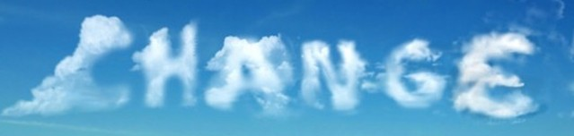 'Change' written in clouds with blue sky