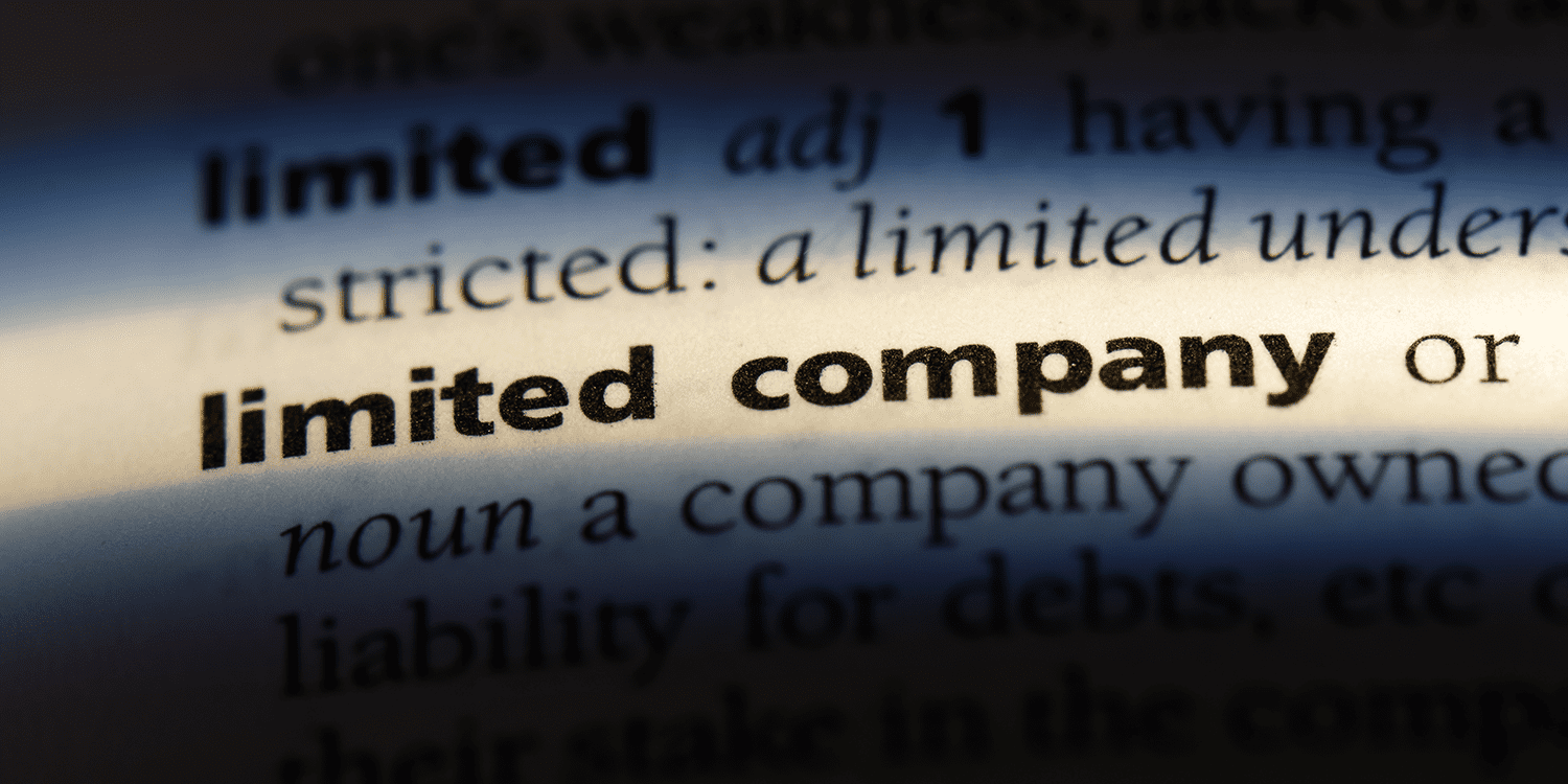 Close-up image of an excerpt from a dictionary entry that provides the definition of a limited company