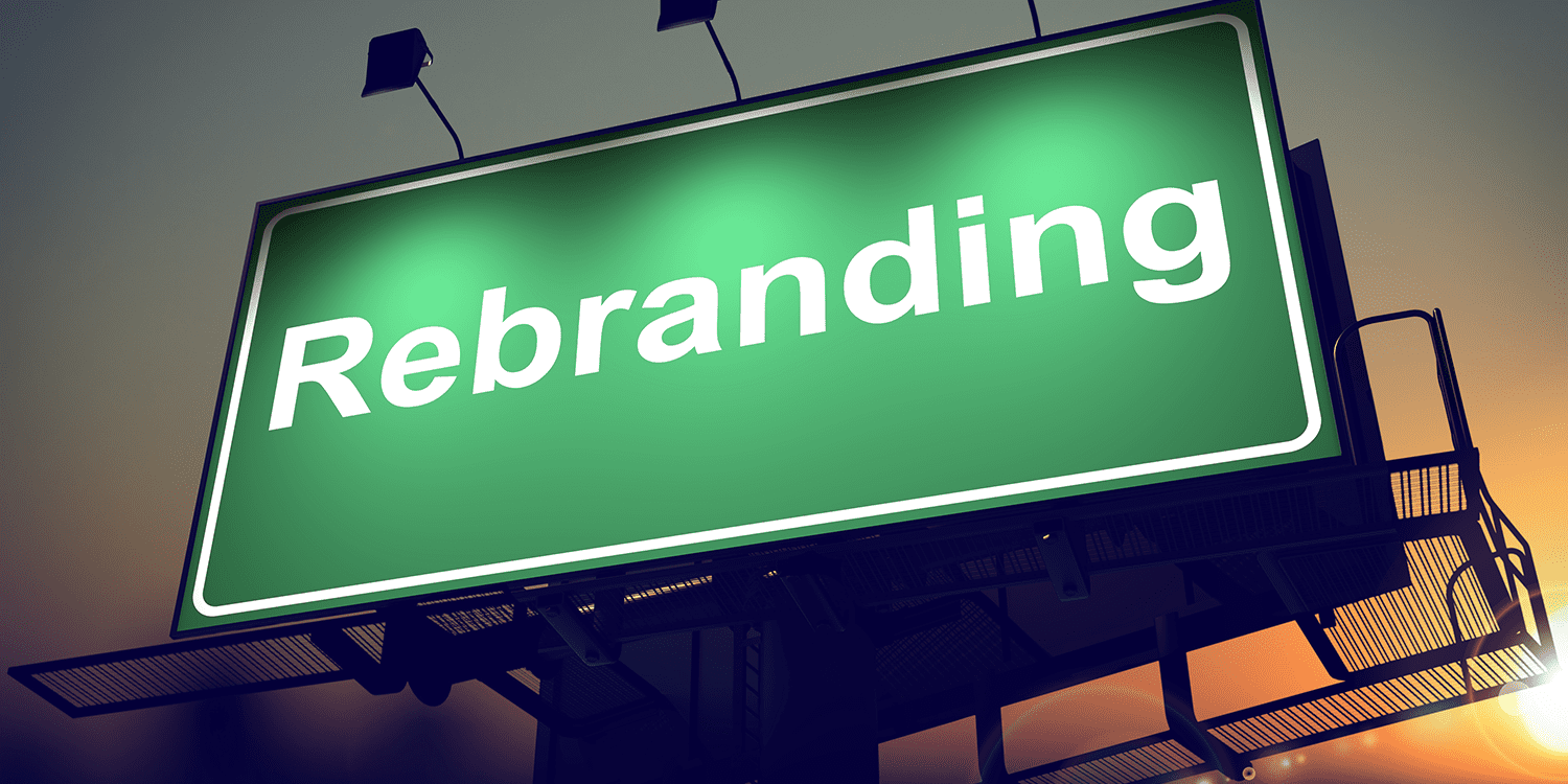 Illuminated sign with the word 'Rebranding' in white text against a green background, illustrating the concept of changing a company name.