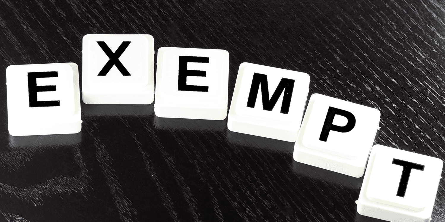 White scrabble tiles that spell the word 'exempt', representing the process of applying for 'limited' word exemption for a company name
