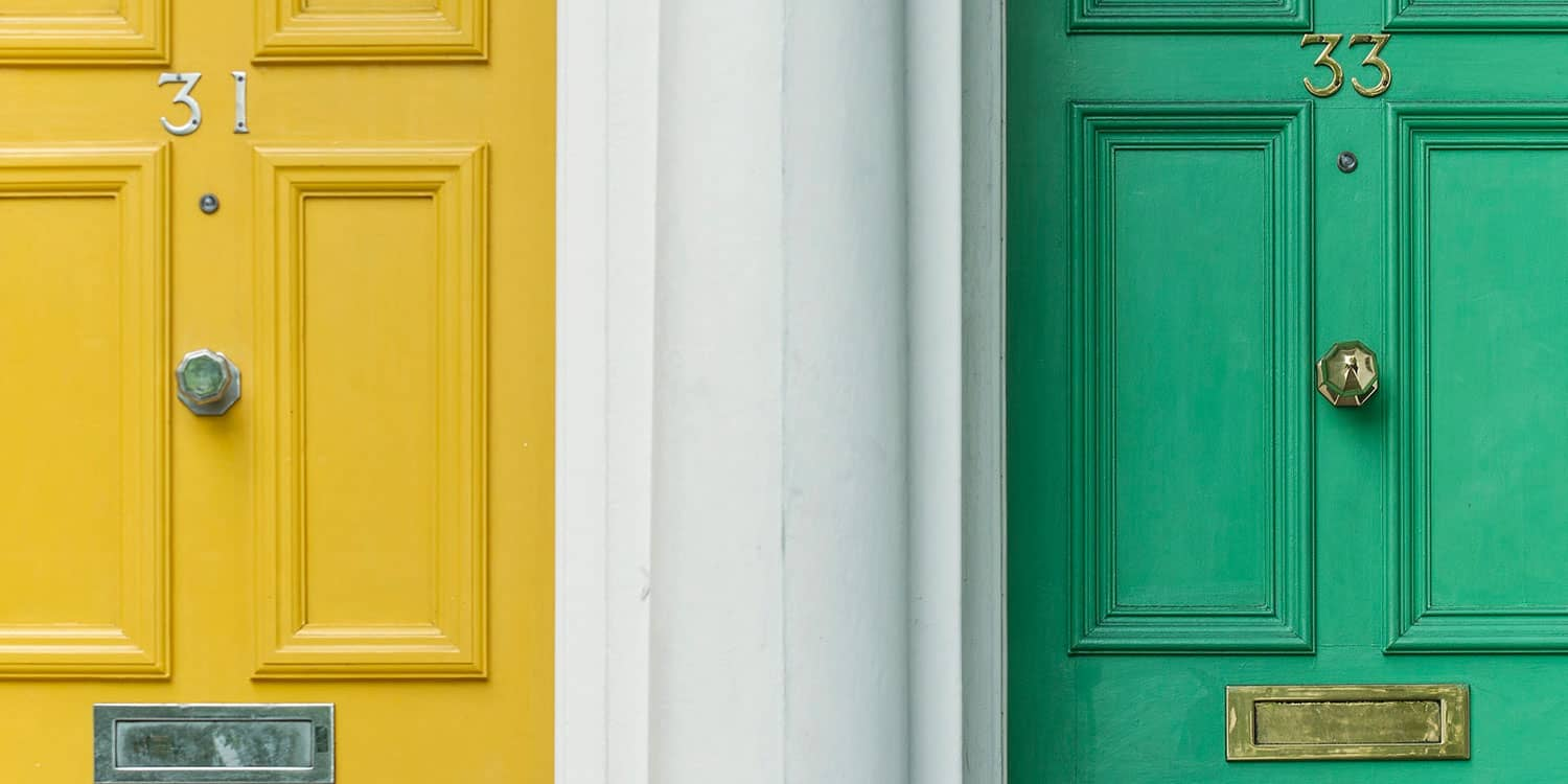 A yellow door marked 31 next to a lime green door marked 33