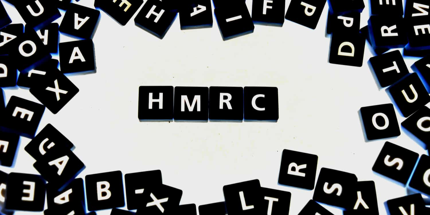 "Four black tiles with white letters displaying the abbreviation ""HMRC""."