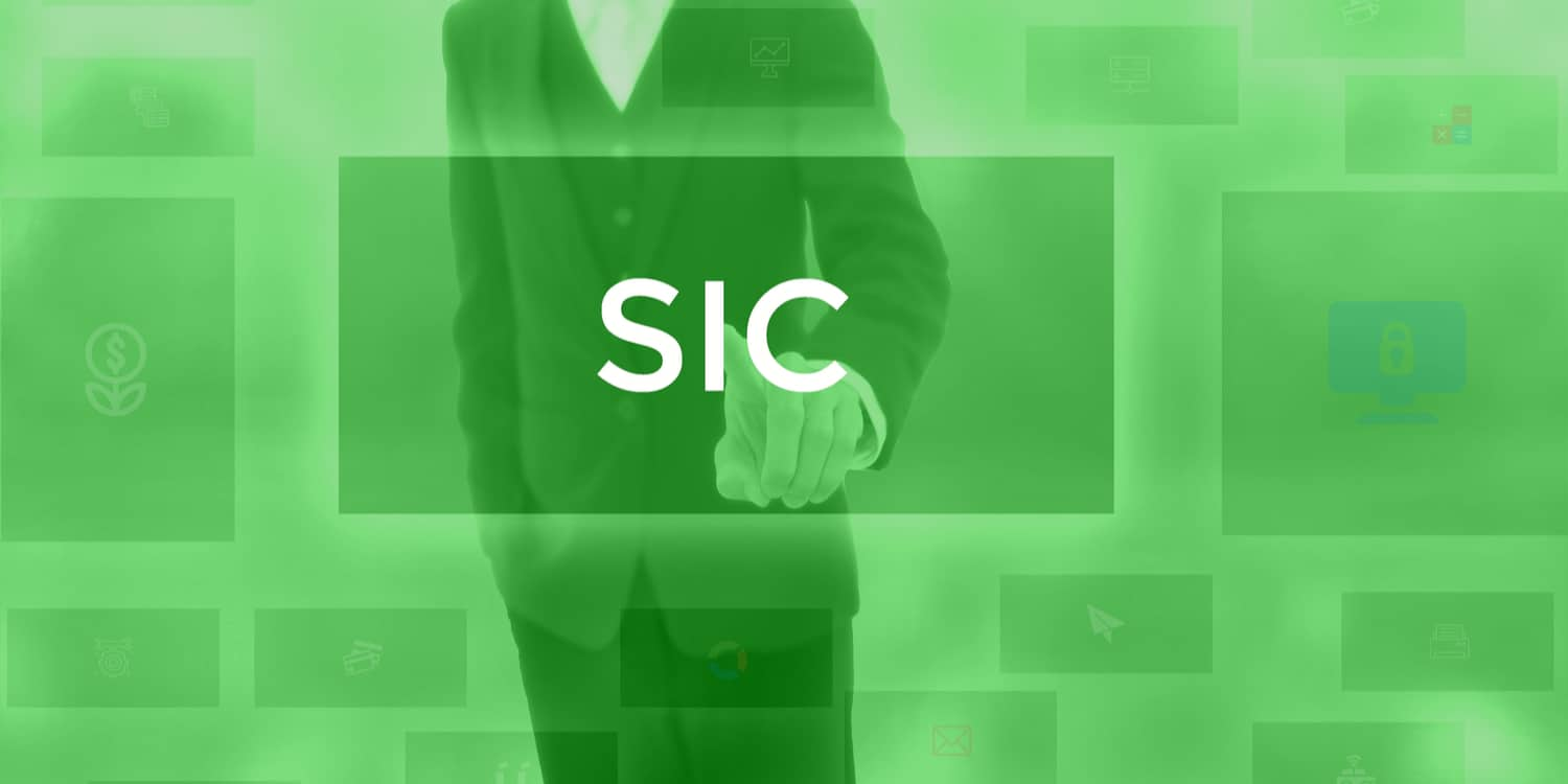 Business person selecting the word 'SIC' as displayed on a full size electronic screen.