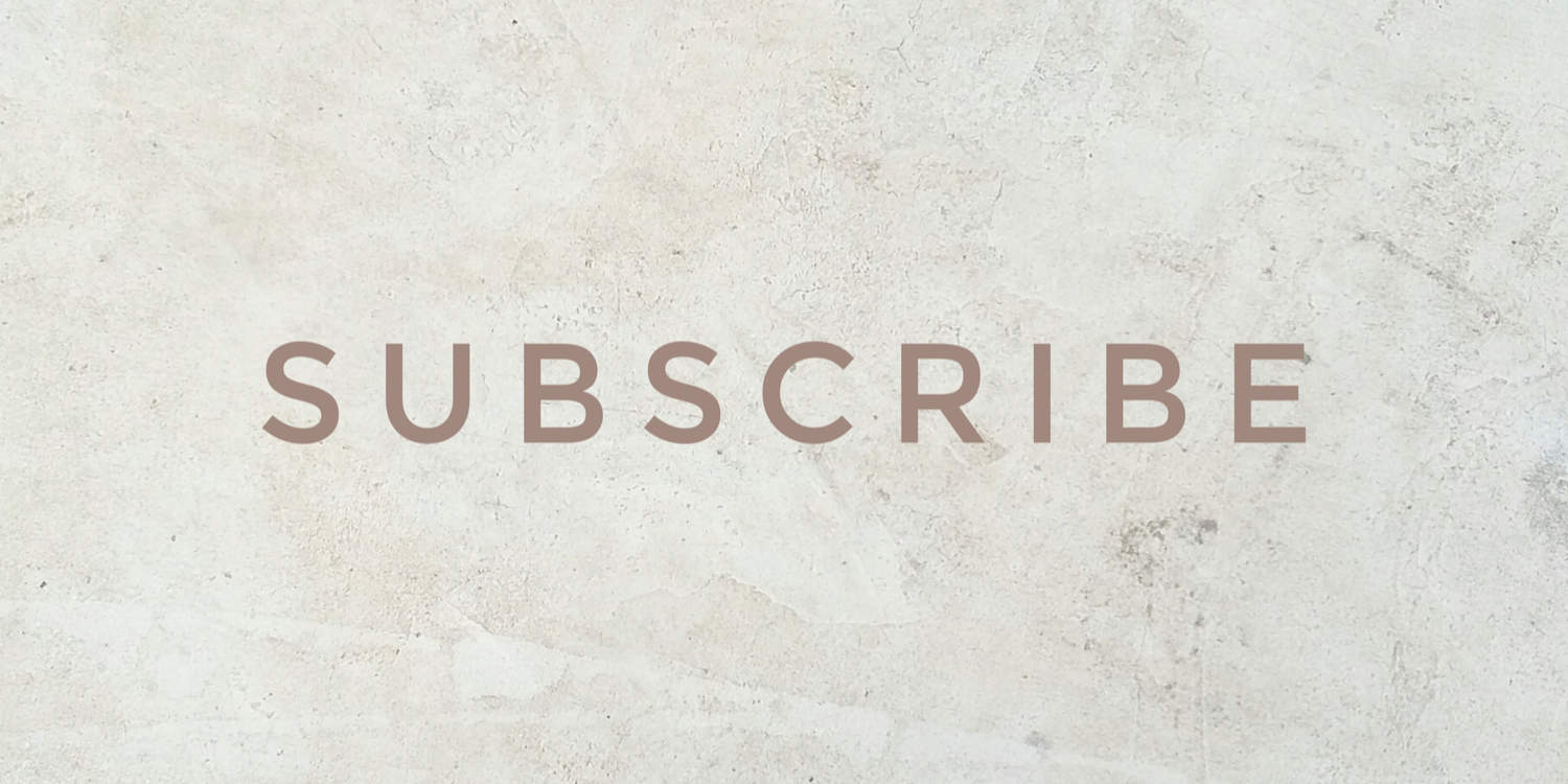 The word 'SUBSCRIBE' in capital letters and beige font colour against a marbled background.