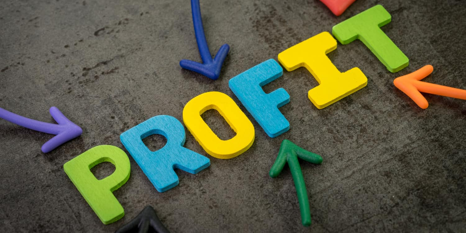 Multi-coloured magnetic letters on a blackboard displaying the word 'PROFIT', illustrating the concept of distributing company profits.