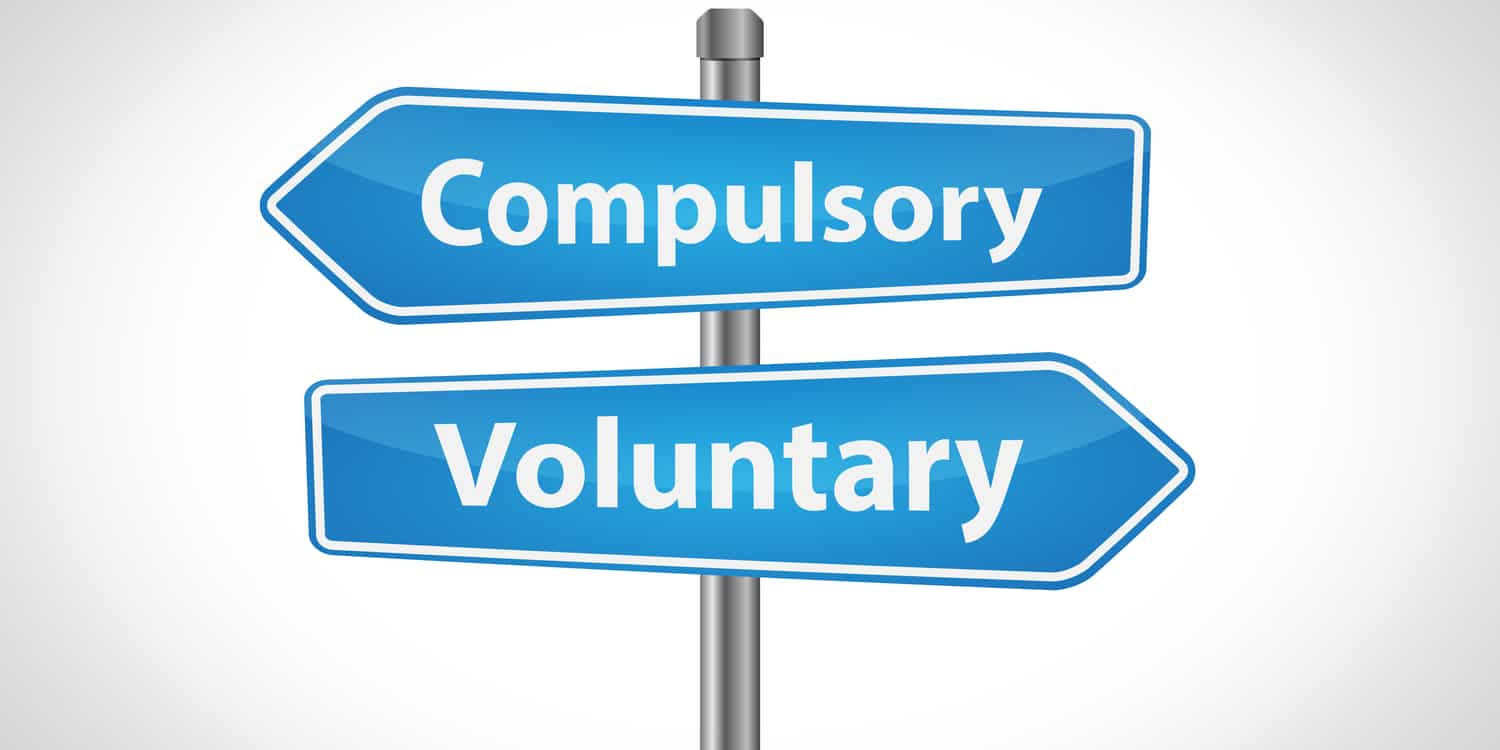 Two directional street signs displaying the words 'Compulsory' and 'Voluntary' - in white text with light blue background.