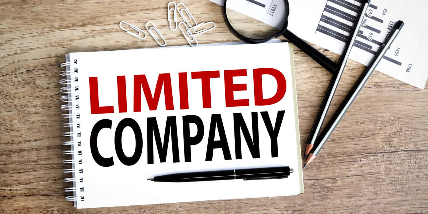 Limited company. text written on white notepad paper on wood background