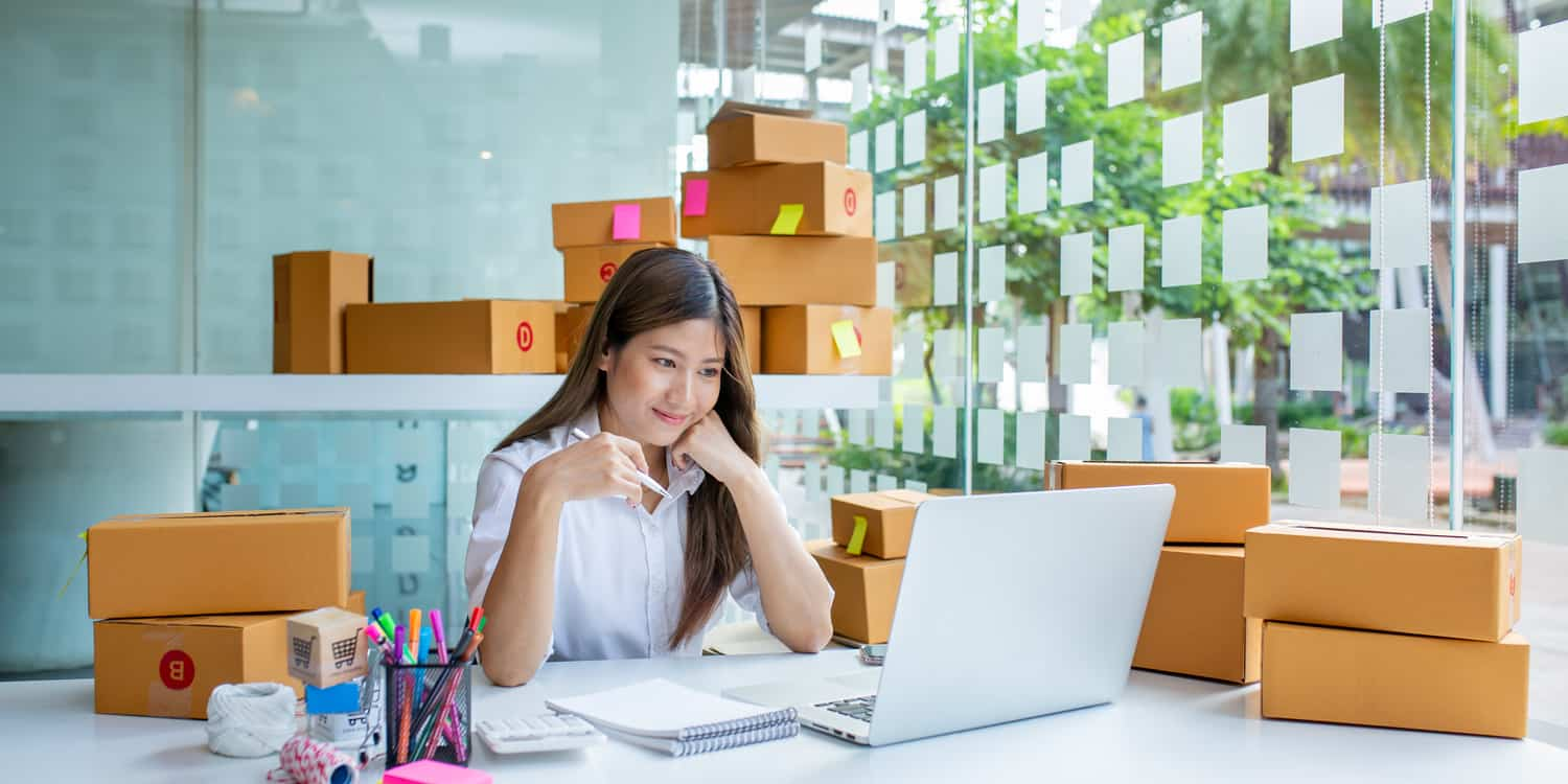 Asian Small business entrepreneur SME working with box at home, SME e-commerce digital technology concept.