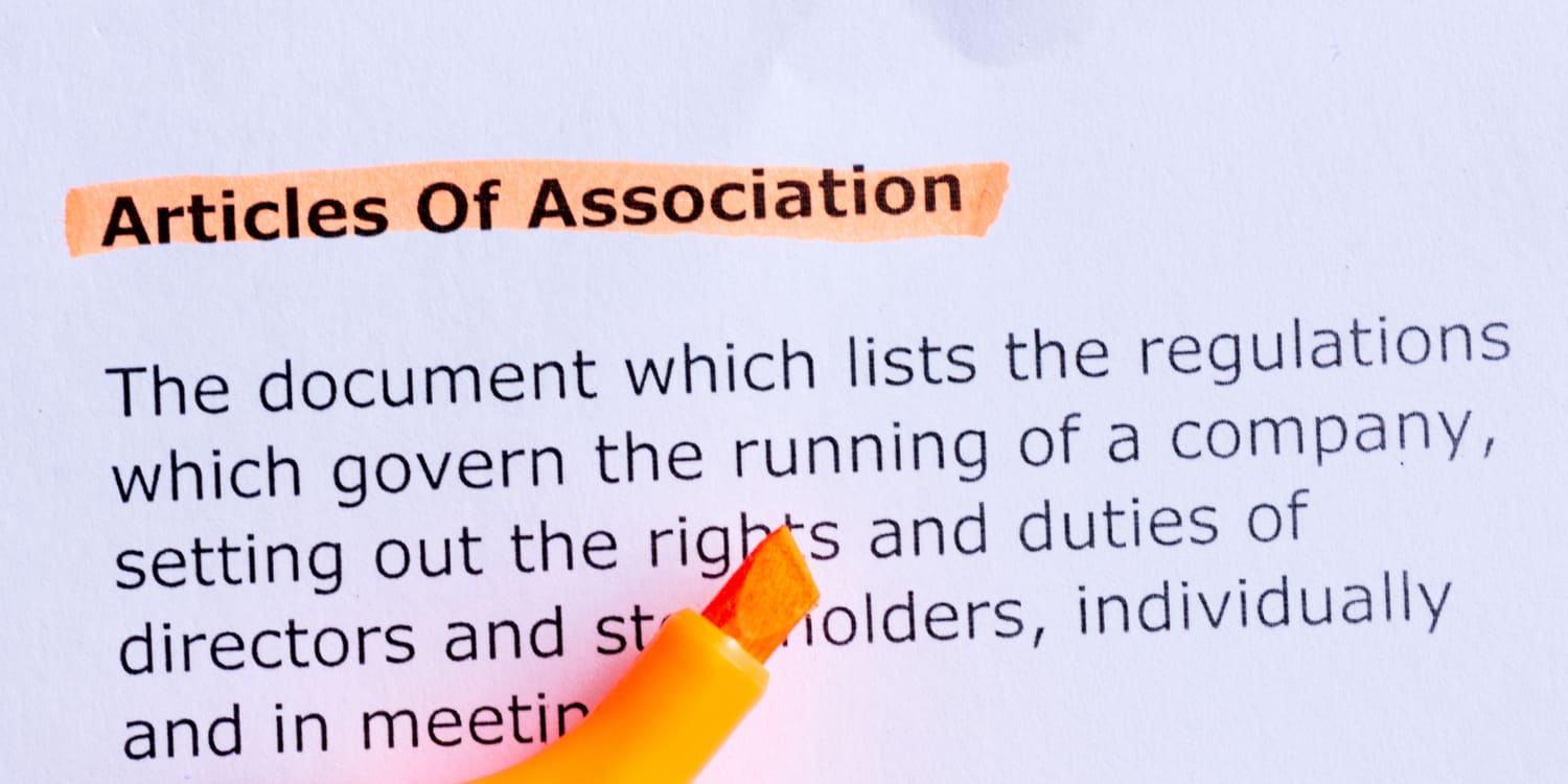 articles of association word highlighted with orange highlighter pen on the white paper